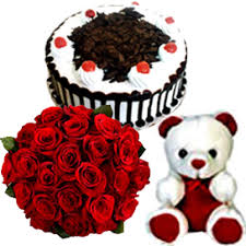 A 10 red roses Bunch 1 2kg Black Forest Cake and small teddy cake