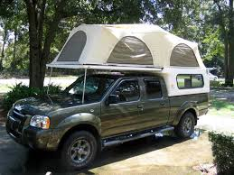 2003 nissan frontier with tent cer