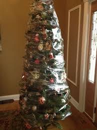 25 Ways To Foil Your Pets Evil Plans Destroy Christmas Tree