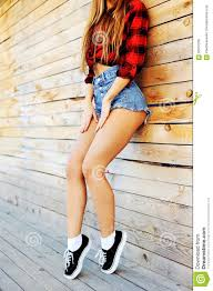 beautiful woman in jeans shorts u0026 sneakers outdoor lifesty stock