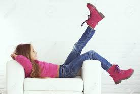 Cute Pre Teen Girl Wearing Fashion Winter Clothes Posing In White Interior Stock Photo