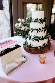 Simple Rustic Elegant Wedding Cake With Greenery And A Wood Slice Stand Gloria Goode