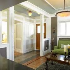 Off White And Cream Coloured Millwork Form The Neutral Base For A Cheerful Wall Ceiling Treatment