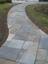 Flagstone Walkway Leading To Sunken Patio