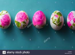 Decoupage Easter Eggs Decorated With Flowered Paper Napkins And Stuck Glue Om Blue Background Above View