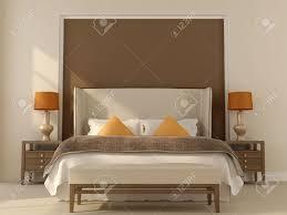 schlafzimmer in beige und brauntönen mit orange dekoration