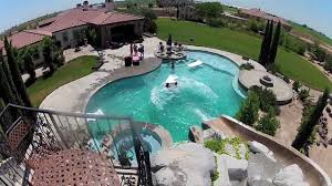 GoPro: Awesome Backyard Pool & Slide - YouTube Best 25 Large Backyard Landscaping Ideas On Pinterest Cool Backyard Front Yard Landscape Dry Creek Bed Using Really Cool Limestone Diy Ideas For An Awesome Home Design 4 Tips To Start Building A Deck Deck Designs Rectangle Swimming Pool With Hot Tub Google Search Unique Kids Games Kids Outdoor Kitchen How To Design Great Yard Landscape Plants Fencing Fence