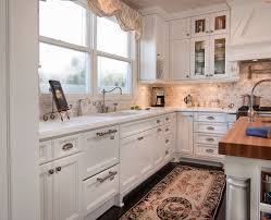 traditional kitchen with tile by smith brothers construction