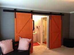 Interior. Orange Wooden Sliding Barn Door Hanging On Black Flat ... Amazoncom Hahaemall 8ft96 Fashionable Farmhouse Interior Bds01 Powder Coated Steel Modern Barn Wood Sliding Fascating Single Rustic Doors For Kitchens Kitchen Decor With Black Stool And Ana White Grandy Door Console Diy Projects Pallet 5 Steps Salvaged Ideas Idea Closet The Home Depot Epbot Make Your Own Cheap