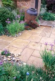 Stone Patio With Rustic Urn Irises Spring Flowering Plants 3742