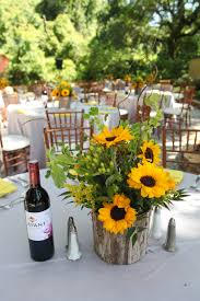 Sunflower centerpieces with wooden bases Centerpieces