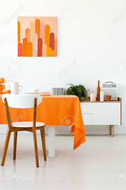 White Wooden Chair At Table With Orange Cloth In Dining Room.. Stock ... Ding Table And Chairs In Style Of Pierre Chapo Orange Fniture 25 Colorful Rooms We Love From Hgtv Fans Color Palette Leather Serena Mid Century Modern Chair Set 2 Eight Chinese Room Ming For Sale At Armchairs Or Side Living Solid Oak Westfield Topfniturecouk Zharong Stool Backrest Coffee Lounge Thrghout Ppare Dennisbiltcom Midcentury Brown Beech By Annallja Praun Lumisource Curvo Bent Wood Walnut Dingaccent Ch Luxury With Walls Stock Image Chair Drexel Wallace Nutting Mahogany Shield Back