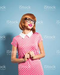 cheerful beautiful red hair young woman wearing polka dot dress