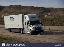 100 Prime Inc Trucking Phone Number Silver SemiTruck Traveling Along A Rural US Highway