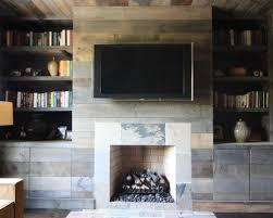 Mountain Style Living Room Photo In Atlanta With A Standard Fireplace And Wall Mounted