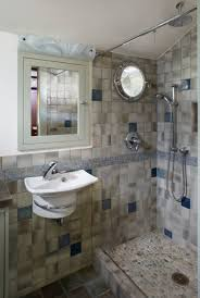 bathroom small bathroom with mix green and blue tiles with