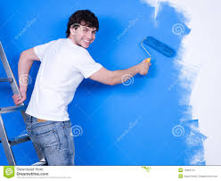 Happy Man Painting The Wall