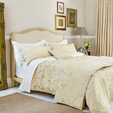 White Wooden Bed With Bedding Gold White Pillows And Duvet White