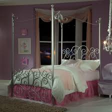 silver chrome Canopy Beds with white bedding bed with pink sheet