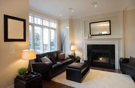 A Small Living Room With Dual Use Ottoman And Coffee Table Top Trays
