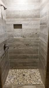 Barnwood Tile Shower with pebble base Rustic Bathroom Other
