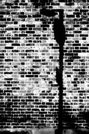 The Closeup Of A Rustic Dark Brick Wall With Lamp Shade Photo