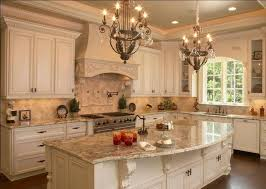 Elements Of A French Country Kitchen Glazed Painted Cabinets Arched Window Corbels Under