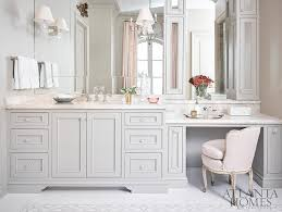 pink and gray master bathroom with pink velvet french vanity chair