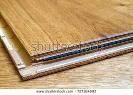 Stock Photo Brown Wooden Parquet Floor Planks Installation Close Up Carpentry Concept 727184692