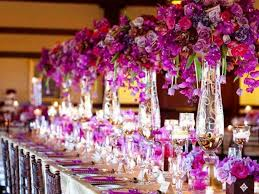 Purple Table Wedding Flowers Decoration In Thin Glass Vases And Small Candles On Long