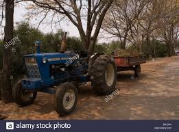 Old Farm Tractor With Trailer