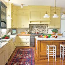 Our All Time Favorite Kitchen This House Pastel Yellow Kitchen Cabinets Pack A Punch