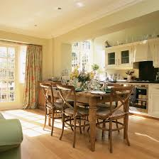 Family Kitchen Diner With Wood Flooring White Cabinetry Oak Dining Table And Chairs