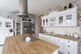 Opted For White Custom Cabinetry That Looks Like Freestanding Furniture They Removed Plaster Walls To Expose Beautifully Weathered Brick Butcherblock