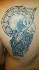 Grey Ink Abstract Clock Tattoo On Shoulder