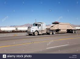 Truck Pulling Bottom Dump Belly Dump Trailer Stock Photo, Royalty ... Dump Trailers For Sale In Tx Equipment Services Kirack Cstruction Properties Airport Sitzman Sales Llc 2006 Ranco Lw2140 Bottom Dump Trailer Belly Dura Haul 247 Help 2103781841 Otto Trucking Tandem Belly Sand Haul Youtube Kw Day Cab Belly Dump Trailer Johns 187 Ho Scale Models 2019 Triaxle Southland Intertional Trucks Wwwdeonuntytarpscom Truck Tralers Tarp Systems 2012 Cross Country Williston Nd Truck Details Truck Langston Concrete Inc Trailers