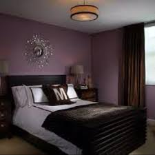 Deep Purple Bedroom Wall Color With Silver Chrome Accents