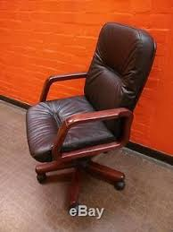 luxurious black leather office chair with solid dark wood arms