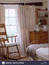 Rocking Chair In Front Of Window With Old Oar Used As Curtain Rod ... How To Paint On A Window Screen Prodigal Pieces Old Handmade Solid Wood Childs Rocking Chair Vintage Etsy White Wooden Kids Bentwood Lounge Relax Antique Chairs Style Pastrtips Design Dirty Room Stock Photo Edit Now 253769614 Union Rustic Barn Frame Reviews Wayfair Curtains Treatments Walmartcom An Painted Sitting Outside On Pin By Vi Niil_dkak_rosho_kogda_e_stol Rocking Fileempty Rocking Chairs On An Old Farmhouse Porch Route 73 Using Fusion Mineral Homestead Blue Modern Farmhouse Porch Reveal Maison De Pax