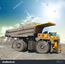 Yellow Mining Trucks Stock Photo 25167775 - Shutterstock Boss Magazine Driverless Trucks To Disrupt Canadas Oil Sands The Largest Chinese Ming Truck Wtw220e Cat Marks Ming Truck Milestone New 797f For Sale Thompson Agriculture Haul Trucksdhs Diecast Colctables Inc Innovations In Open Cut Ming Bend Tech Group Komatsu Updates 730e With Ac Electric Drive Monster Test South Africa Carmagcoza Ore Safford Mine Arizona Experience Float Quick Hitch Towing System For Trucks Cbmax Unveils Autonomous Haulage Vehicle A That Blast And Spray Pating Of Central Victorian