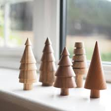 A Collection Of 10 Hand Made Wooden Tree Ornaments These