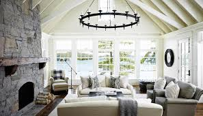 Amazing Living Room Features A Vaulted Ceiling Accented With An Iron Ring Chandelier Hanging Over Pair Of Ivory Sofas Adorned Gray Mitered Pillows