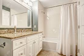 white bathroom vanity cabinet with granite top and mirror aqua