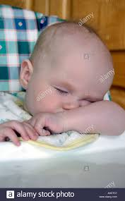 Baby Sleeping In Highchair Stock Photo: 5529792 - Alamy High Angle Closeup Of Cute Baby Boy Sleeping On High Chair At Home My Babiie Mbhc1 Compact Highchair Herringbone Buy Online4baby How Do I Know If Child Is Overtired Sleepwell Sleep Solutions Closeup Stock Amazoncom Chddrr Easy Clean Folding Baby Eating Portable Cam Istante Chair 223 Amore Mio Super Senior Brand Bybay Cosleeping Cot White Natural Shower New Baby Star Virginia High Chair Adjustable Seat Back Rest Cute Photo Dissolve