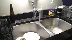 reduction in water flow at kitchen sink faucet after running water