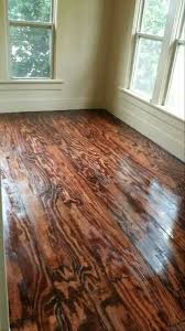 This DIY Floor Project Was Made From Plywood We Took 13 Full Sheets Of And Ripped The Into 6 In Wide 8 Ft Long Planks Then Glues Down With