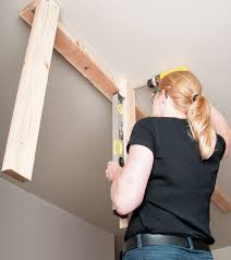 Installing Ceiling Joist Hangers by How To Install Overhead Garage Storage Diy Stanley Tools