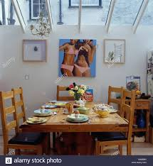 Large Picture Of Girls In Bikinis On Wall Small Dining Room Extension With Simple Pine