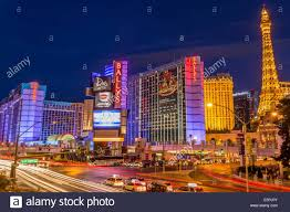 Neon lights on Las Vegas Strip with car headlights leaving light