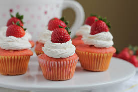 Classic Strawberry Cupcakes with fresh whipped cream and topped with a strawberry These cupcakes are